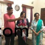 Wg Cdr and Mrs. Suma Athri welcoming Ms. Kiran Mazumdhar shaw at home